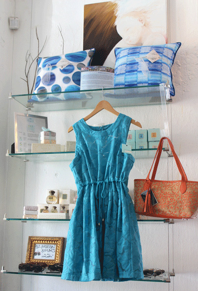 Designer pillows and turquoise dress